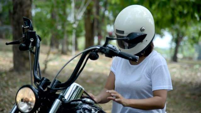 woman taking off motorcycle helmet. - woman taking clothes off stock videos and b-roll footage