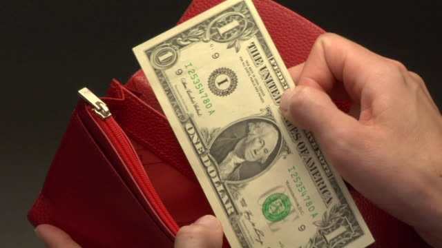CU, Woman taking one American dollar bill from wallet, close-up of hand