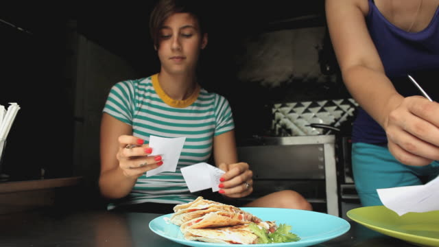 ms woman taking orders in taco truck / jersey city, new jersey, usa - taco stock videos & royalty-free footage