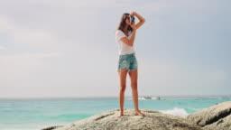 Woman taking photo at beach