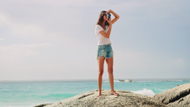 woman taking photo at beach - camera photographic equipment stock videos & royalty-free footage