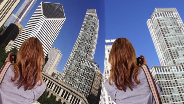 woman taking photo with camera of buildings in downtown chicago, back to camera - viewpoint stock videos & royalty-free footage