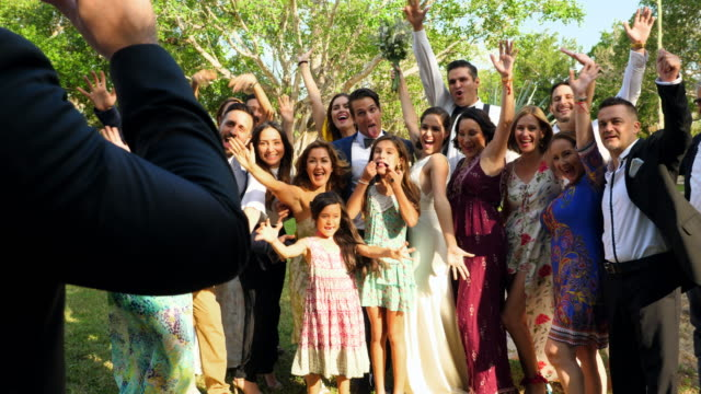 ms woman taking photo with smartphone of wedding party after ceremony - large group of people stock videos & royalty-free footage