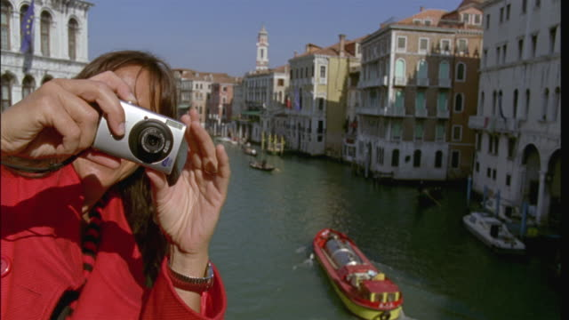 cu slo mo woman taking photos from  rialto bridge above grand canal/ venice, italy - 50 54 years stock videos & royalty-free footage