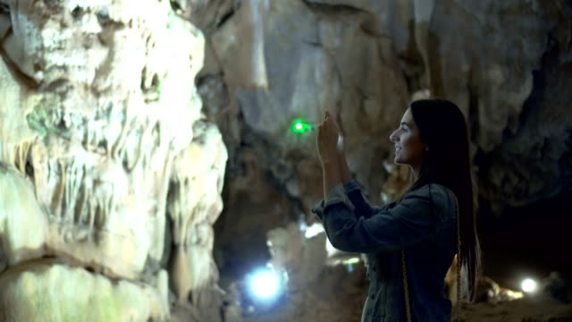 Woman taking photos in a Cave