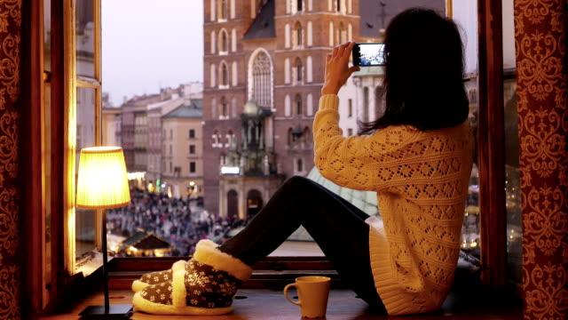 woman taking photos of krakow - leg warmers stock videos & royalty-free footage