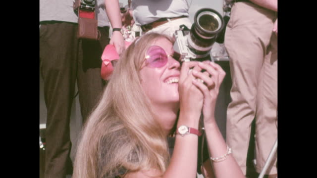 vídeos de stock e filmes b-roll de woman taking photos of the apollo-11 launch, the first manned space craft due to land and walk on the moon from the kennedy space center in florida.... - prt