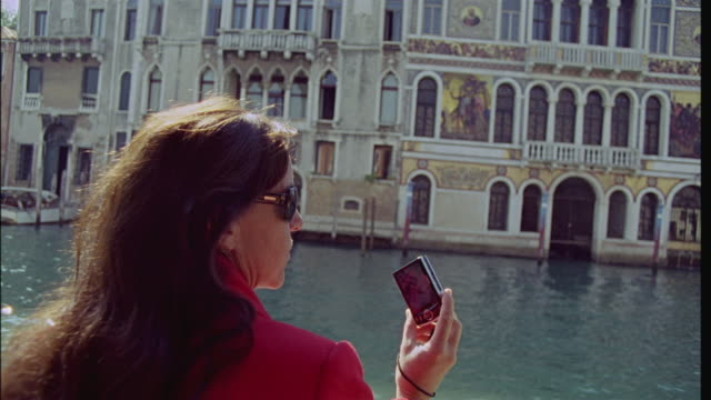 CU SLO MO Woman taking photos with digital camera while taking gondola ride on Grand Canal/ Venice, Italy