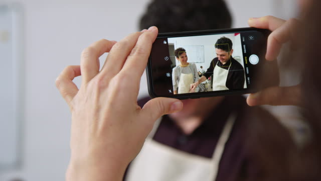 woman taking photos with her phone at pasta workshop - filming stock videos & royalty-free footage