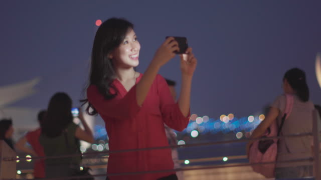 ms woman taking photos with smartphone in modern city - technophile stock videos & royalty-free footage
