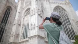 Woman taking picture of Duomo Cathedral
