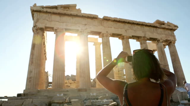 woman taking picture to parthenon - parthenon athens stock videos and b-roll footage