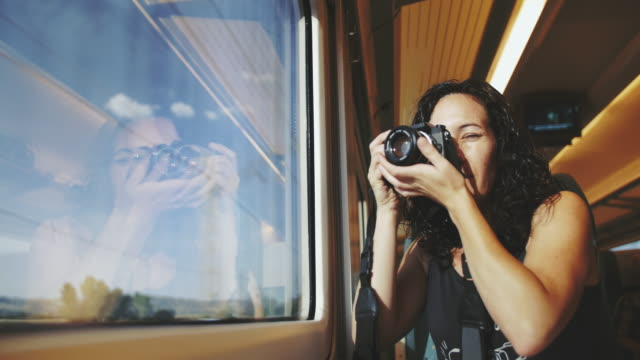 Woman taking pictures at the train