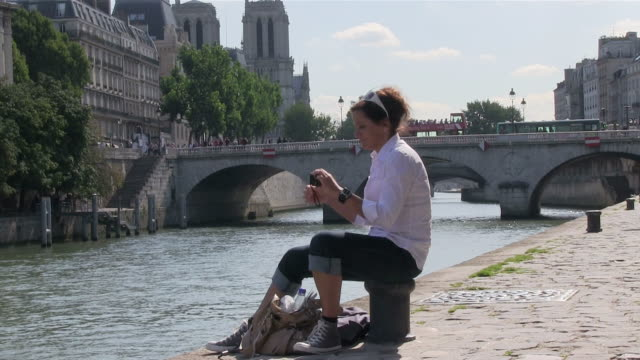 ms woman taking pictures near river seine / paris, ile-de-france, france    - real time stock videos & royalty-free footage