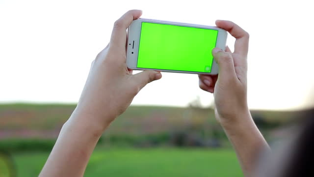 Woman Taking Pictures With Phone
