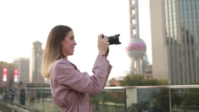 woman taking pictures with professional camera - tourist stock videos & royalty-free footage