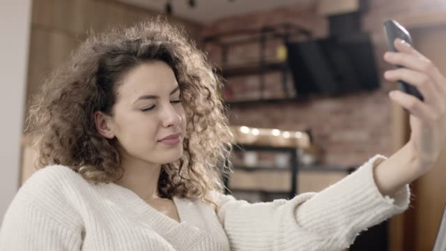 woman taking selfie at home - hoozone stock videos and b-roll footage