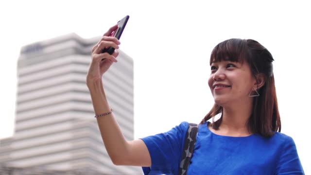 市の女性撮影 selfie - 撮影テーマ点の映像素材/bロール