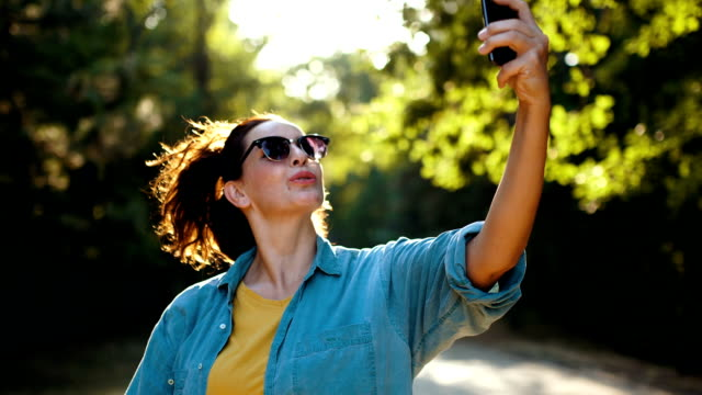Woman taking selfie in nature