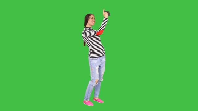 Woman taking selfie on mobile phone