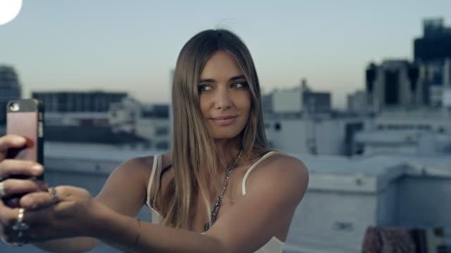 Woman taking selfie on rooftop