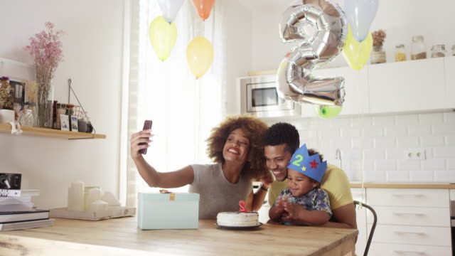 woman taking selfie with family during birthday - number 2 stock videos & royalty-free footage