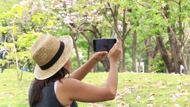 Woman taking selfie with smart phone