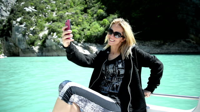 woman taking selfies - pedal boat stock videos and b-roll footage