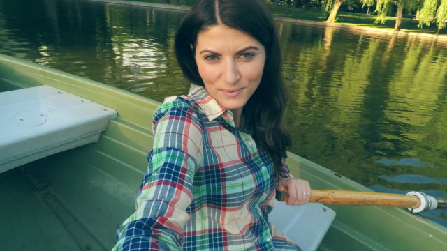 Woman taking selfies while rowing.