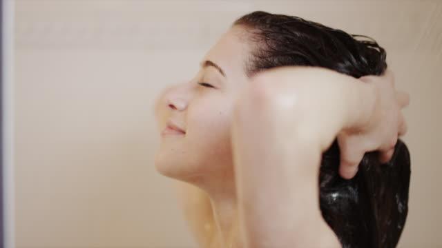CU Woman taking shower / Salt Lake City, Utah, USA