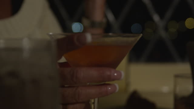 woman taking sip of martini - martini stock videos & royalty-free footage