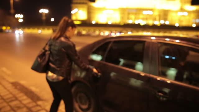 woman taking uber while talking on mobile phone. - arrival stock videos & royalty-free footage