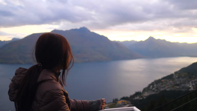 woman taking view at queenstown view point - queenstown stock videos & royalty-free footage