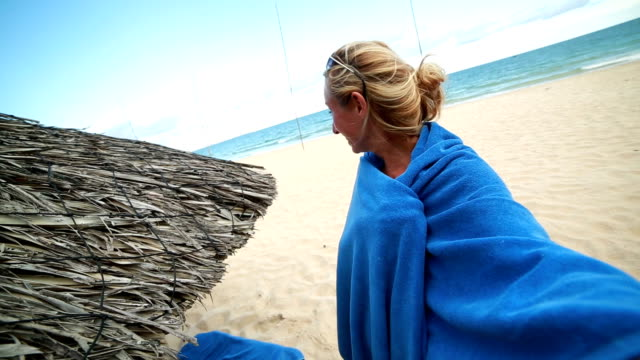 woman talking a selfie by the beach - wrapped in a towel stock videos & royalty-free footage