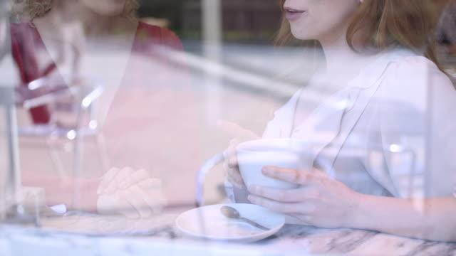 Woman talking in cafe