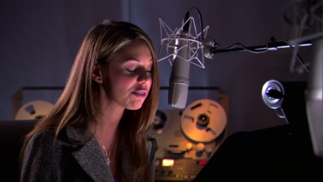 woman talking into microphone in recording studio - see other clips from this shoot 1429 stock videos & royalty-free footage