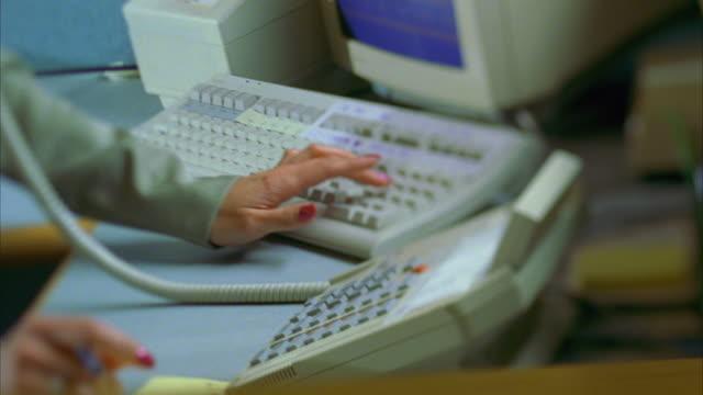 ms tu slo mo woman talking on phone and using computer / canyon lake, texas, usa - computer equipment stock videos & royalty-free footage