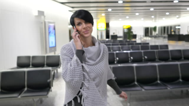 Woman talking on phone at the airport