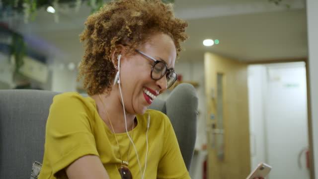 woman talking on phone - tilt down stock videos & royalty-free footage