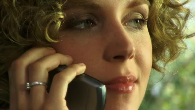 ecu, woman talking on phone - detaljbild bildbanksvideor och videomaterial från bakom kulisserna