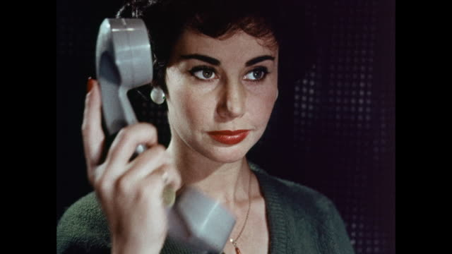 vidéos et rushes de montage woman talking on telephone / united kingdom - 1950 1959