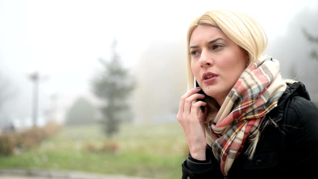 woman talking on the phone - negatives stock videos & royalty-free footage