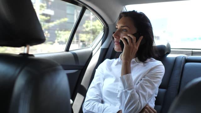 woman talking phone on car - car interior stock videos & royalty-free footage