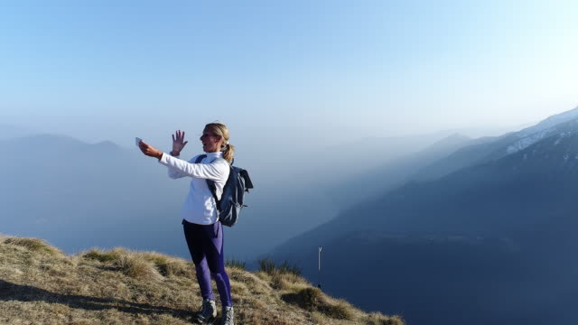 woman talking selfie from mountain top - mountain peak stock videos & royalty-free footage