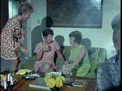 1971 MONTAGE Woman talking to guests at dinner party, Los Angeles, California, USA, AUDIO