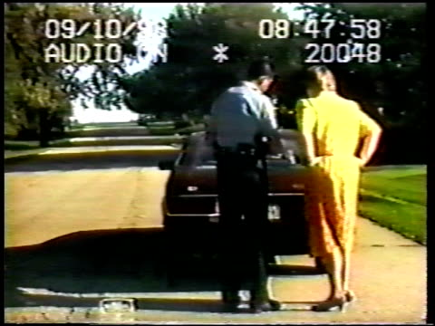/ woman talking to policeman tells him about her whole day / when woman cannot find her checkbook or driver's license she becomes frazzled and out of... - driver's license stock videos and b-roll footage