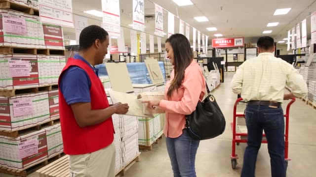 Woman talking to salesman in home improvement store for marble