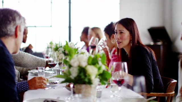 ms woman talking with friends at table during dinner party - dinner party stock videos & royalty-free footage