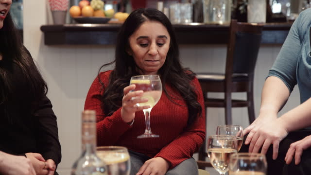 woman talking with her friends in restaurant - paralysis stock videos & royalty-free footage