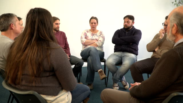 4K DOLLY: Woman talking with others in Support Group Therapy circle
